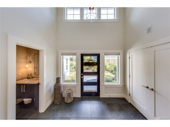 Gracious entry with slate tile and vaulted ceilings.
